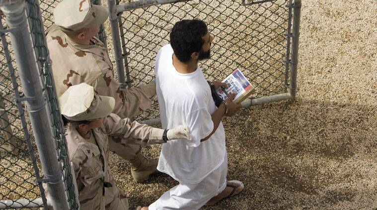 A judge is putting off resolution of dispute over use of female guards in highest security unit of Guantanamo Bay.