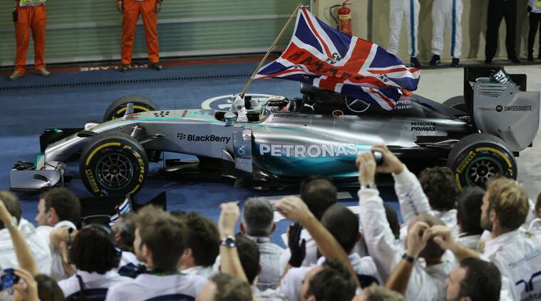 Lewis Hamilton of Britain carries the British flag after he wins the Abu Dhab Formula one at the Yas Marina racetrack (Source: AP)