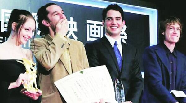 Director Josh Safdie (R) reacts next to his brother, Benny Safdie as they receive the Tokyo Grand Prix for Heaven Knows What, which they directed together during the closing ceremony of the Tokyo International Film Festival in October.
