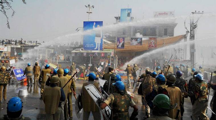 Police and Sant Rampal's followers indulge in violent clashes at Satlok Ashram in Hisar on Tuesday. Supporters of Rampal indulged in clashes with the police to resist his arrest. (Source: PTI Photo)