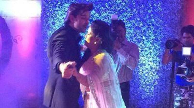 While Hrithik looks every bit of a Greek God that he is, Arpita looks the perfect shy bride.