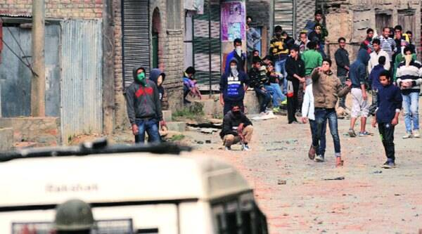 Protesters clash with police in Srinagar on Wednesday. ( Source: Express photo by Shuaib Masoodi)