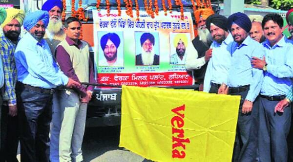 Ajmer Singh Bhagpur flags off the home delivery van for rural areas, in Ludhiana on Tuesday.