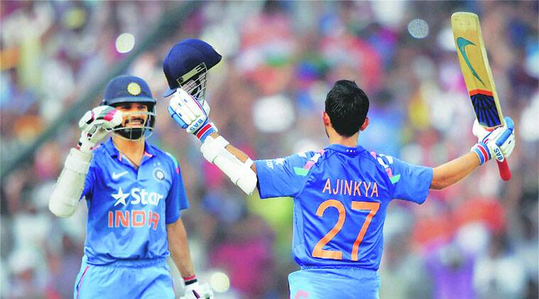 Ajinkya Rahane celebrates after reaching his hundred during the first ODI against Sri Lanka in Cuttack on Sunday. (PTI)