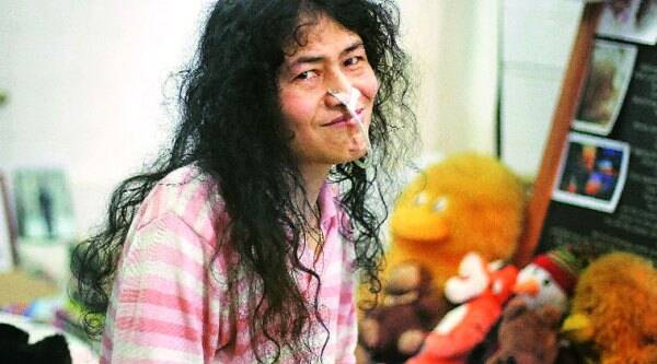 Irom Sharmila (left) cradles Thoi, a pair of guinea pigs she has adopted in confinement. (Source: Deepak Shijagurumayum)