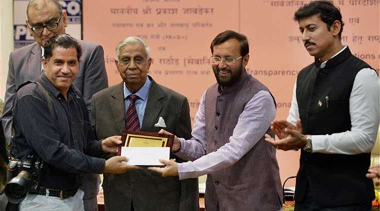 Environment Minister Prakash Javadekar presents prize a PTI photo journalist at a function on National Press Day in New Delhi on Sunday. Justice (Retd.) MN Venkatachaliah and Press Council of India Chairman Markandeya Katju and MOS Col Rajyavardhan Singh Rathore are also seen. (Source: PTI)