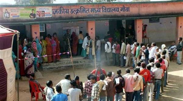 People wait to cast votes at a polling station during the first phase of Jharkhand Assembly elections in Latehar on Tuesday. (PTI Photo)