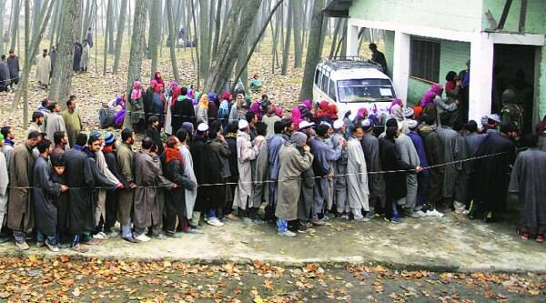 Queue outside a polling station in Ganderbal, last represented by Omar Abdullah. (Source: IE photo by Shuaib Masoodi)