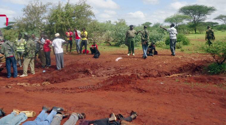 Kenyan security forces examine the scene, as bodies of some of the victims lie in a line on the ground, at the location of an attack on a bus about 50 kilometers (31 miles) outside the town of Mandera, near the Somali border in northeastern Kenya, Saturday, Nov. 22, 2014. Somalia's Islamic extremist rebels, al-Shabab, attacked the bus in northern Kenya at dawn on Saturday, singling out and killing 28 passengers who could not recite an Islamic creed and were assumed to be non-Muslims, Kenyan police said. (Source: AP Photo)