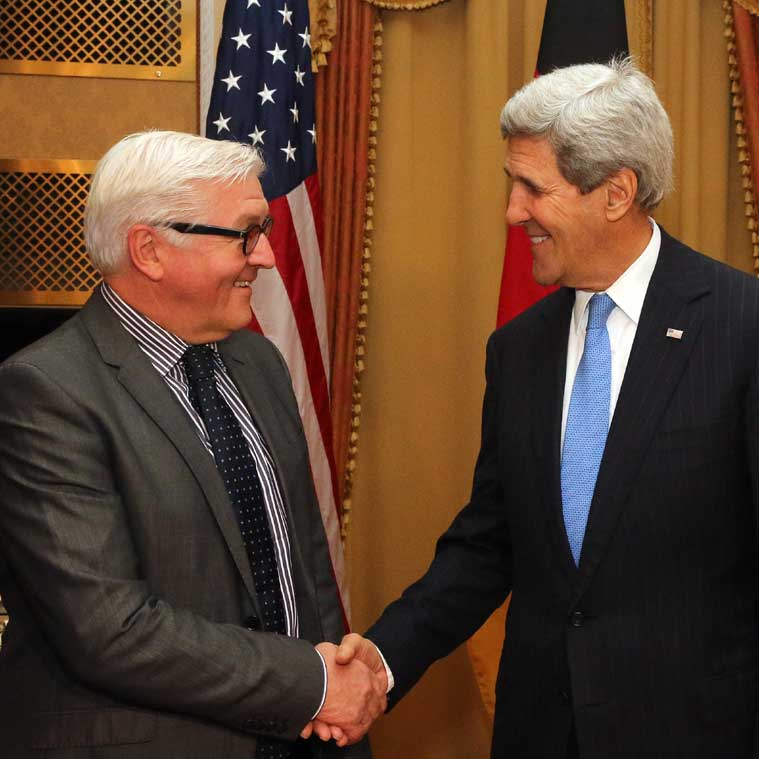 German Foreign Minister Frank-Walter Steinmeier , left, and U.S. Secretary of State John Kerry, shake hands as they met during closed-door nuclear talks with Iran in Vienna, Saturday. (Source: AP)