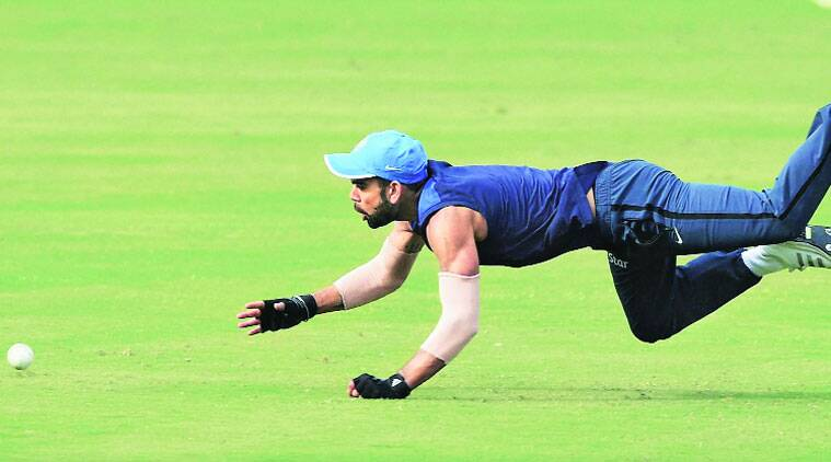 Team India skipper Virat Kohli dives to stop a ball during a training session in Cuttack on Saturday. (PTI)