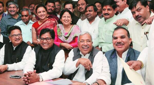 Newly-elected Rajya Sabha members Ram Gopal Yadav with Neeraj Shekhar and others accepting certificates at the state assembly in Lucknow on Thursday. (Source: Express photo by Vishal Srivastav)
