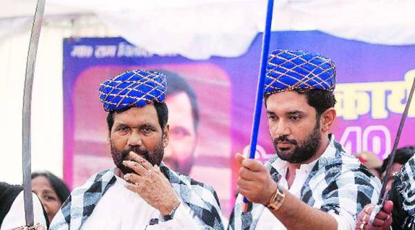 Union Minister Ram Vilas Paswan with his son and MP Chirag Paswan at a Lok Janshakti Party workers' meeting, in Lucknow on Tuesday. (Express photo by Vishal Srivastav)