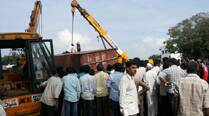 At least eight crushed to death after metal container detaches fromtruck