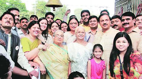 Minister of state Mahesh Sharma with his family and supporters at a temple in Noida on Sunday. (Source: Express photo)