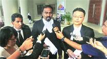 First lawsuit from relatives of MH370 victims filed by 2boys