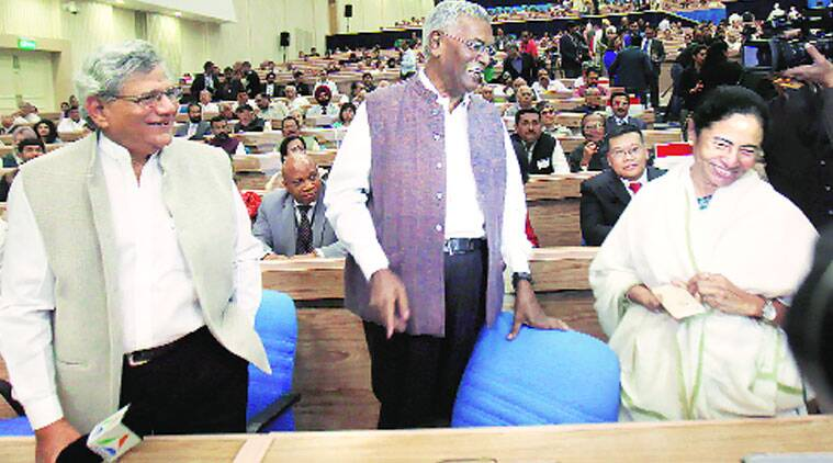 West Bengal CM Mamata Banerjee, CPM's Sitaram Yechury and D Raja share a light moment at a function to mark the 125th birth anniversary of Jawaharlal Nehru at Vigyan Bhawan in New Delhi on Monday. (Source: PTI)