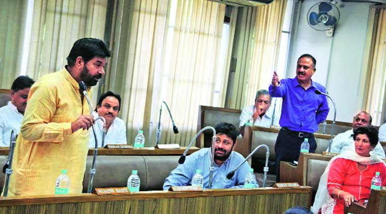 Councillor Subhash Chawla (left) makes a point during the Municipal Corporation House meeting in  Sector 17, Chandigarh, on Friday. (Source: Express photo by Sumit Malhotra)