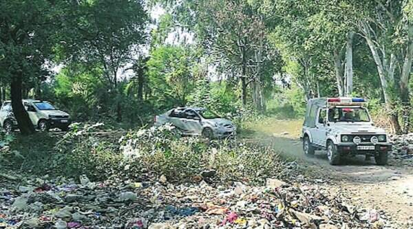 A police team at the spot where Mehram's body was found, in Mohali on Thursday. (Source: Express photo)