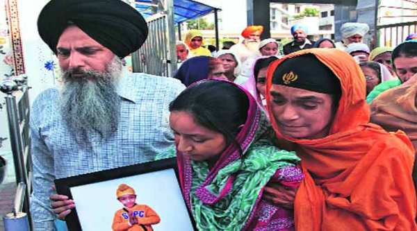Mehram's mother Harinder Kaur with his photo