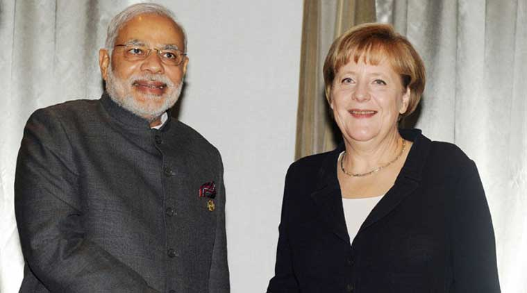 Prime Minister Narendra Modi at a meeting with the German Chancellor Angela Merkel, in Brisbane on Australia on Sunday. (Source: PTI)