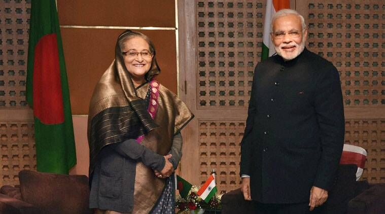 narendra modi, modi in bangladesh, narendra modi bangladesh visit, modi bangaldesh visit, sheikh hasina, sheikh hasina narendra modi, dhaka, narendra modi dhaka, bangladeshi workers, bangladesh news, world news