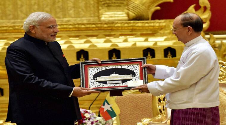 Prime Minister Narendra Modi receives a memento from President of Myanmar, U Thein Sein during a meeting at Presidential Palace in  Myanmar on Tuesday. PTI