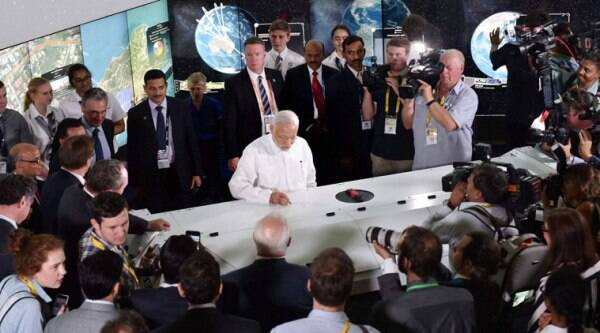 Prime Minister Narendra Modi signs on an Agro Robot during a visit to Queensland University of Technology in Brisbane, Australia on Friday. (Source: PTI)