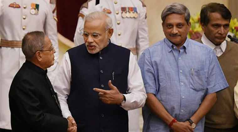 President Pranab Mukherjee and Prime Minister Narendra Modi with the newly sworn-in minister Manohar Parrikar at the swearing-in ceremony at Rashtrapati Bhavan in New Delhi on Sunday. (Source: PTI)