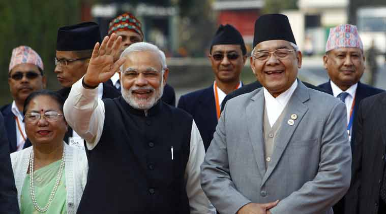 ndian Prime Minister Narendra Modi, waves to the media as he is received by Nepalese Home Minister Bam Dev Gautam, right, upon arrival at the Tribhuwan Airport to attend the 18th summit of South Asian Association for Regional Cooperation (SAARC) in Katmandu, Nepal, Tuesday, Nov. 25, 2014. (Source: