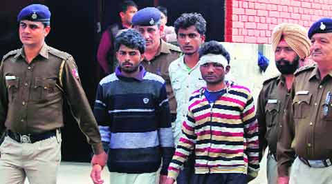 Three accused in police custody in Sector 35, Chandigarh, on Tuesday. (Source: Express photo by Jasbir Malhi)