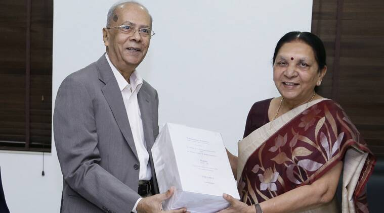 Justice (retired) GT Nanavati Om hands over the final report on Gujarat riots to CM Anandiben Patel. (Source: IE)