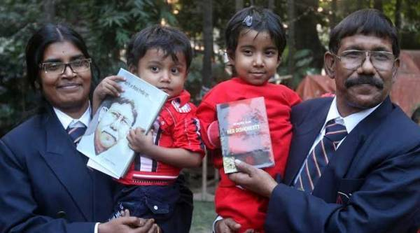 Dr. Nazrul Islam along with his wife Dr Kumud Gupta and children during the inauguration of his book at Kolkata Press club on Tuesday. (Express photo by Partha Paul)