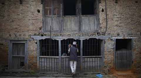A man speaks with a woman inside a house at Khokana, in Lalitpur July 24, 2013. (Source: Reuters photo)