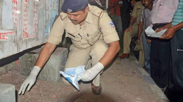 Police officials investigates at the blast site outside the CRPF camp where the NIA officials are probing Bardhaman blast case main accused Sajid Khan. (Source: PTI photo)
