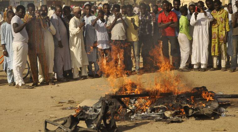 People gather at the site of a bomb explosion in Kano, Nigeria, on Friday. (Source: AP photo)