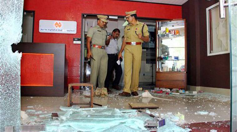 Police officials inspecting the office of Nitta Gelatin India Limited (NGIL), which was attacked in a suspected Maoist attack in Kochi on Monday.(Source: PTI)