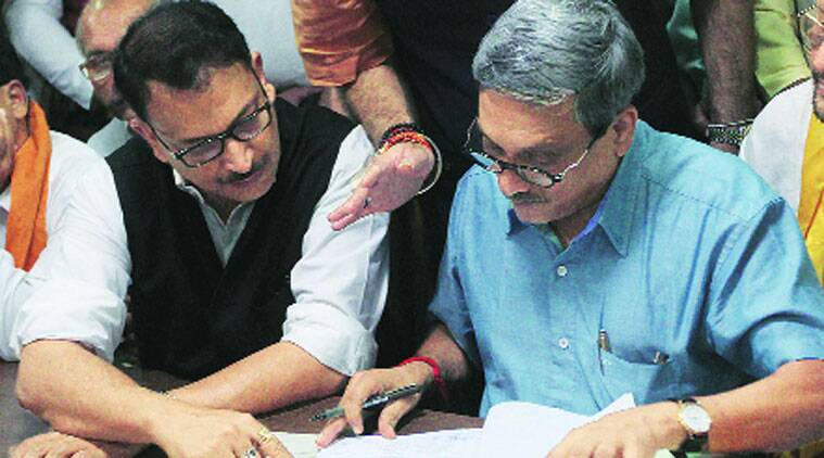Union Defence Minister Manohar Parrikar files nomination papers for Rajya Sabha in Vidhan Sabha as Union Minister of State Rajiv Pratap Rudy looks on, in Lucknow on Monday.  (Source: IE photo by Vishal Srivastav)