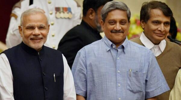 Prime Minister Narendra Modi with newly sworn-in Cabinet ministers Manohar Parrikar and Suresh Prabhu at the oath taking ceremony for new ministers at Rashtrapati Bhavan in New Delhi on Sunday.  (Source: PTI)