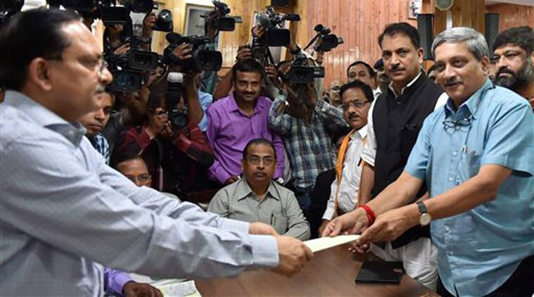 Defence Minister Manohar Parrikar filing nomination papers in Vidhan Bhawan for Rajya Sabha elections, in Lucknow on Monday. Union Minister of State Rajiv Pratap Rudy looks on. (Source: PTI)