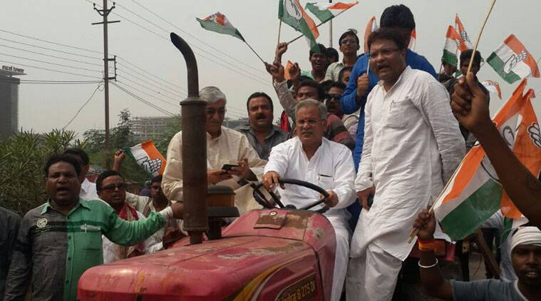 PCC chief Bhupesh Baghel driving a tractor on Saturday. Leader of opposition TS Sinhadev and congress spokesperson SN Trivedi with him. (Source: Express photo)