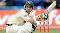 Phil Hughes in induced coma after undergoing surgery