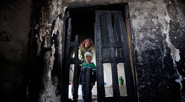 Palestinians inspect damages of a mosque following an attack in the West Bank village of Mughayer, north of Ramallah, Wednesday, Nov. 12, 2014. An attack against a mosque in a West Bank village early on Wednesday ignited a fire that destroyed its first floor, the village's mayor said, blaming Jewish settlers for the attack. (Source: AP)