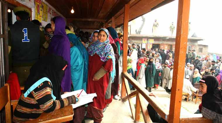 Women outside polling the station as they are waiting for cast their votes in ganderbal. (Source: Express Photo by Shuaib Masoodi)