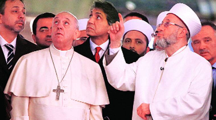 Pope Francis listens to the Mufti of Istanbul, Rahmi Yaran (right), during a visit to the Blue Mosque in Istanbul on Saturday. (Source: Reuters photo)