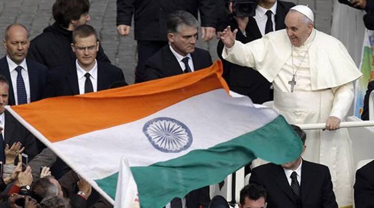 An Indian flag is waved near Pope Francis at the end of the Canonization mass. (Source: PTI)