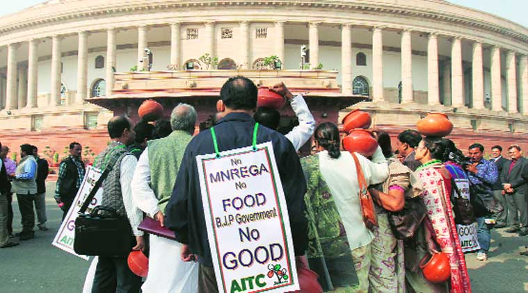 Trinamool Congress MPs hold protest outside Parliament House against the NDA government, Friday. (Source: Express photo by Anil Sharma)