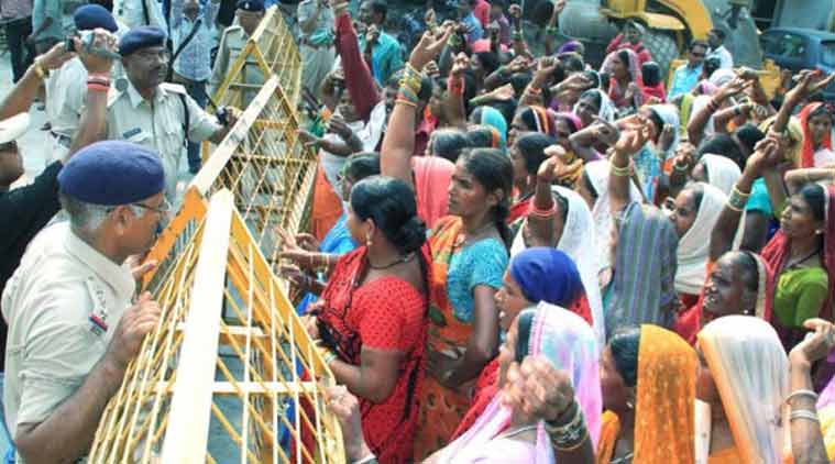 Villagers protesting outside the state health minister's residence against underwent sterilization surgeries, in Bilaspur, Chhattisgarh on Tuesday. (Source: PTI)