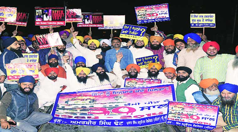 Protesters sit on the rail track demanding justice for 1984 riots victims, in Amritsar on Saturday. (Source: Express photo by Rana Simranjit Singh)