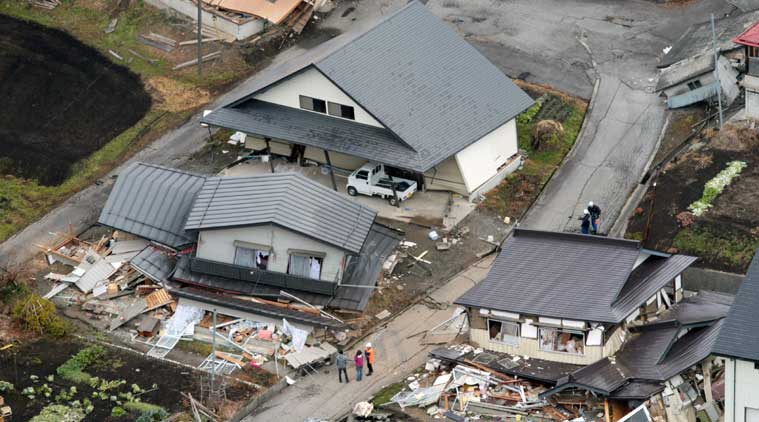 This aerial photo shows houses collapsed after a strong earthquake hit Hakuba, Nagano prefecture, central Japan, Sunday, Nov. 23, 2014. (Source: AP)